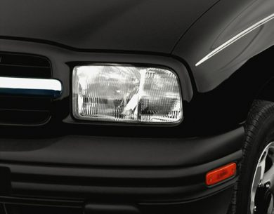 Headlamp  2000 Chevrolet Tracker