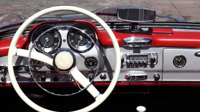 Where can you find a blue book with antique car values?