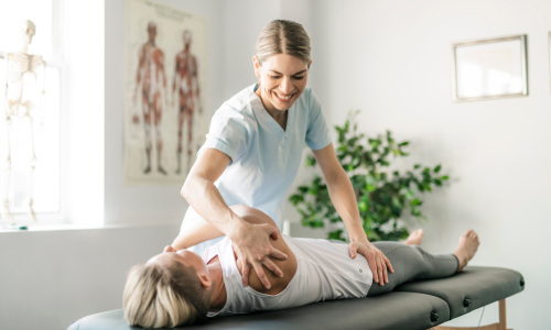 Woman receiving chiropractic care