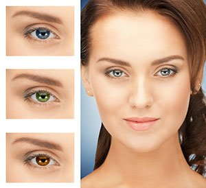 Image of a woman wearing different colored lenses.