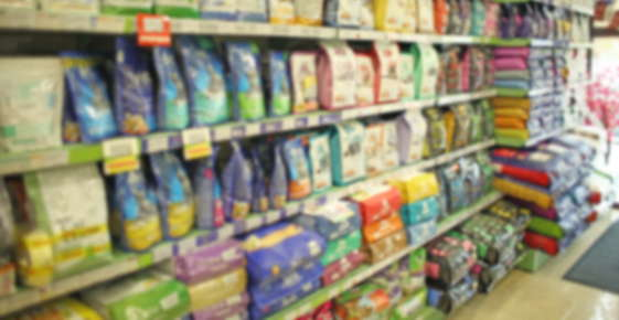 Image of pet food on a store shelf.