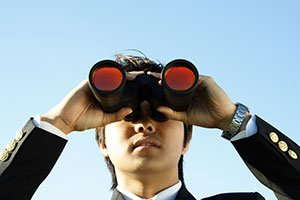 Image of a person using binoculars.