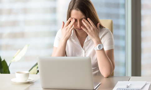 A woman experiencing eyestrain