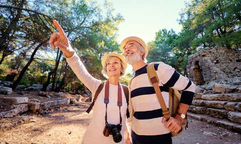 An image of a retired couple who are on an adventurous vacation.