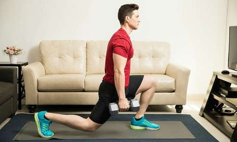 Man doing lunge in home