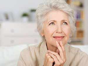 Image of an elderly woman thinking.
