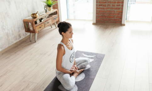 Woman meditating in a peaceful room