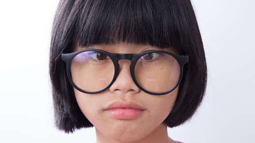 Image of a little girl wearing glasses.