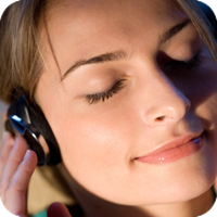 image of woman listening to headphones.