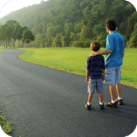 image of man and child walking together.
