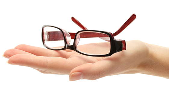 Image of a hand holding glasses.
