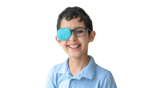 A young boy wearing an eye patch to treat amblyopia.