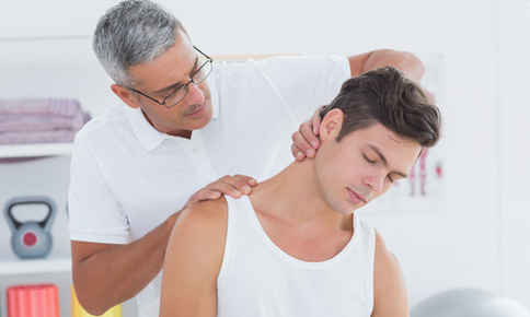 Man receiving a neck adjustment