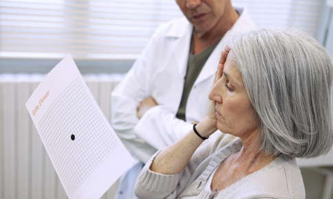 Woman being tested for age-related macular degeneration