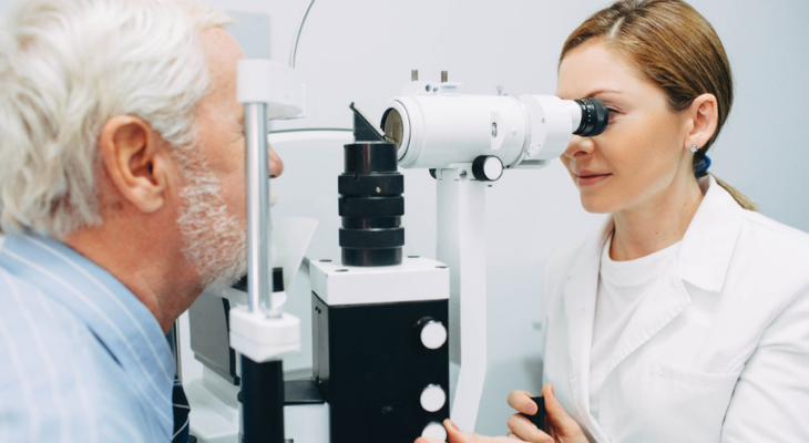 Older man at optometrist having eyes examined