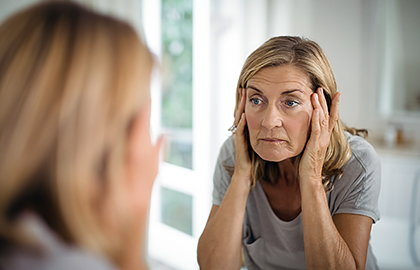 firm-sagging-skin-facelift-in-mirror.jpg