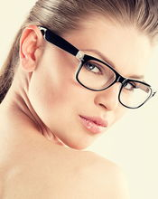 Image of a female looking over her shoulder with eyeglasses on