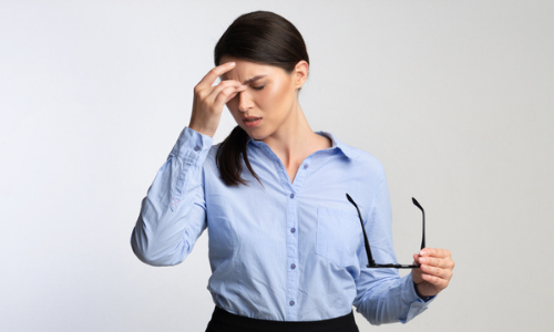 Woman suffering from ocular migraine