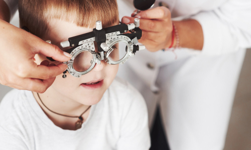 Little boy getting eye exam