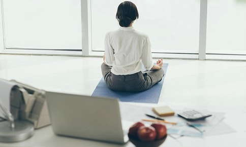 Woman practicing yoga in office