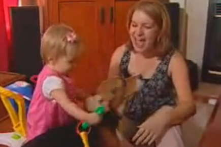 Image of a woman, her toddler daughter, and their dog.