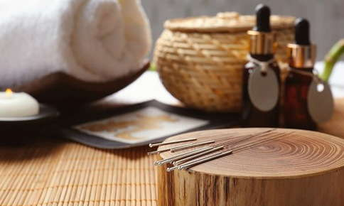 Acupuncture needles, oils, and towels
