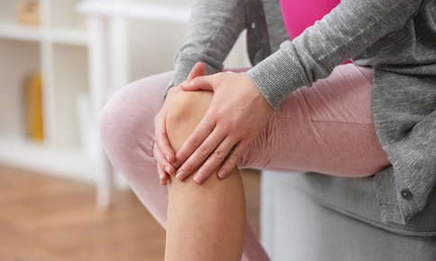 Woman experiencing joint pain