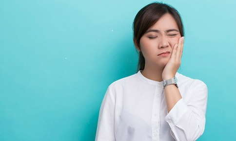 Woman in pain from TMJ