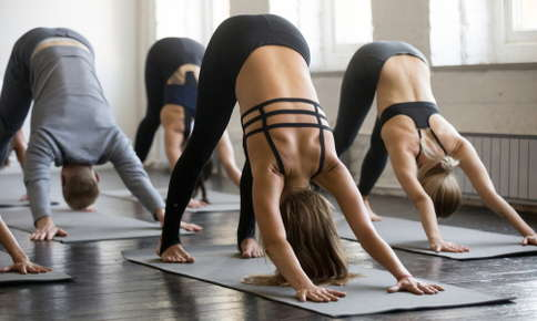 Yoga class in downward dog