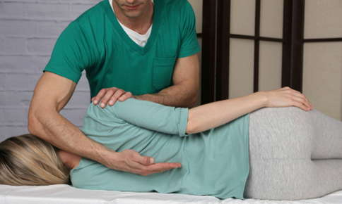 Woman receiving chiropractic adjustment.