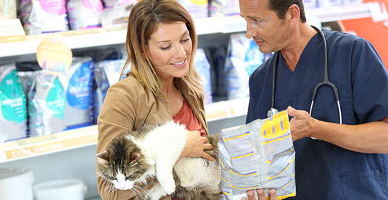 Image of a woman shopping for pet food.