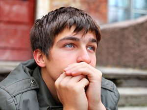 Image of a teenage boy staring into the distance.