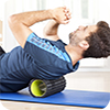 image of man using foam roller.