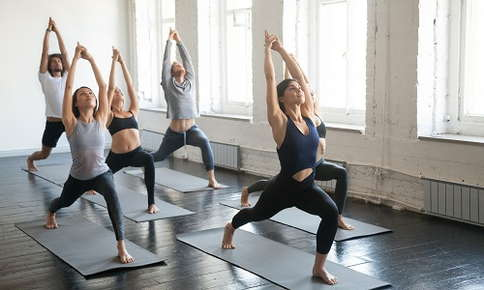 Group yoga class in crescent lunge