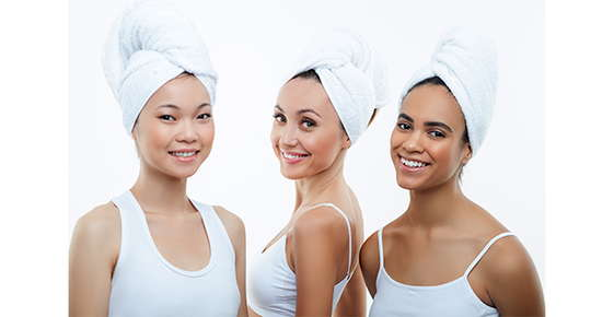 Image of three women with their hair tied up in towels.