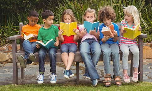 Children reading in a row
