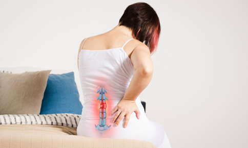 Woman experiencing pain in spine