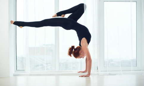 Woman doing an inverted yoga pose