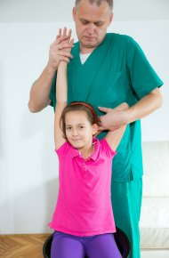 image of a chiropractor doing an adjustment on a young girl