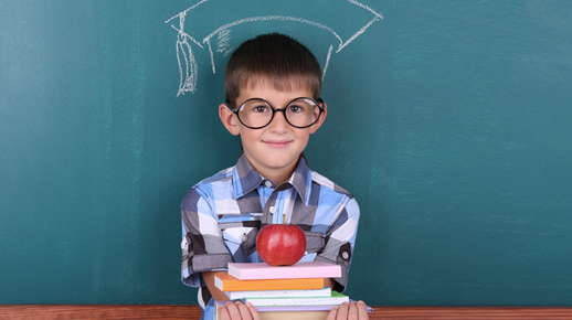 boy with glasses in classroom