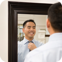 Image of man looking at himself in mirror.