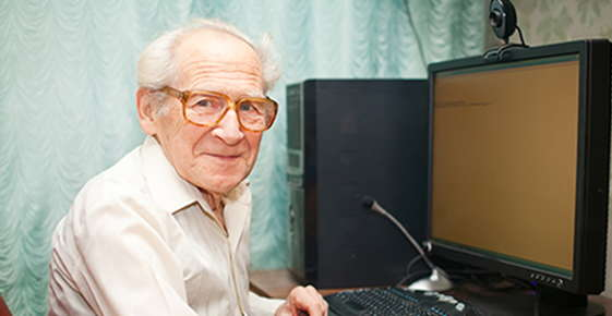Image of old man at the computer.