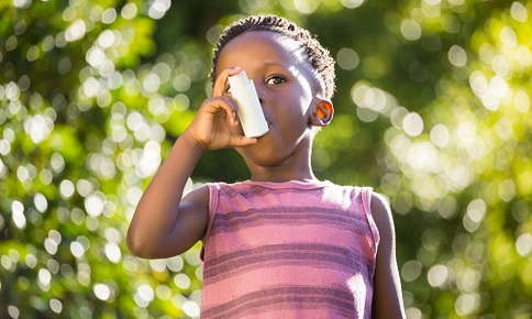 Child uses inhaler outdoors