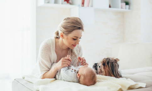 Newborn baby with mom and pet dog
