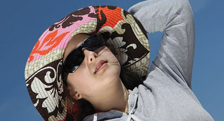 Wide-brimmed hats and sunglasses protect the skin