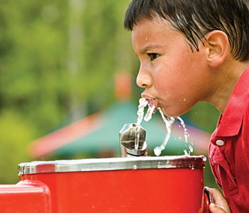 Child drinking water.