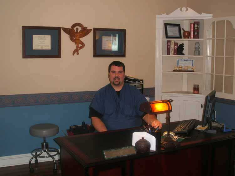 Dr. Conrad sitting in his office - Back pain whiplasgh chiropractor north wales pa