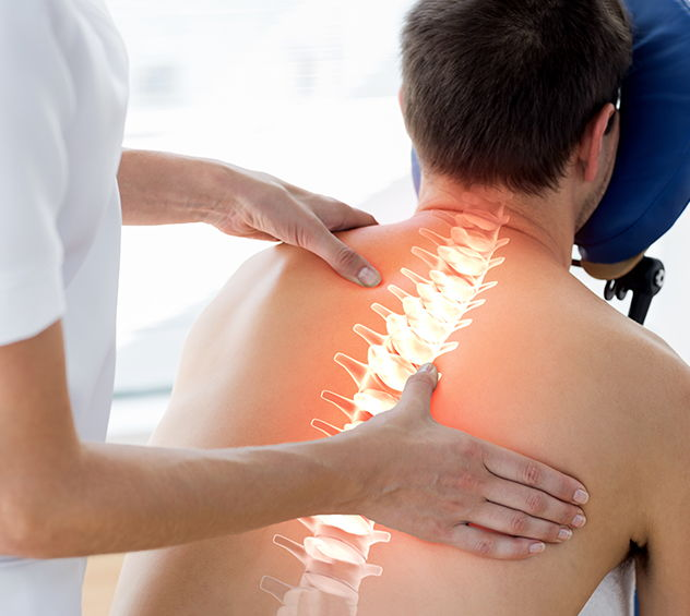 Chiropractor adjusting patient on massage chair with spine illuminated