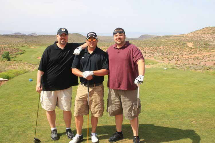 Doctor smiling with his friend while golfing - North Wales PA Chiropractor Golfs Utah