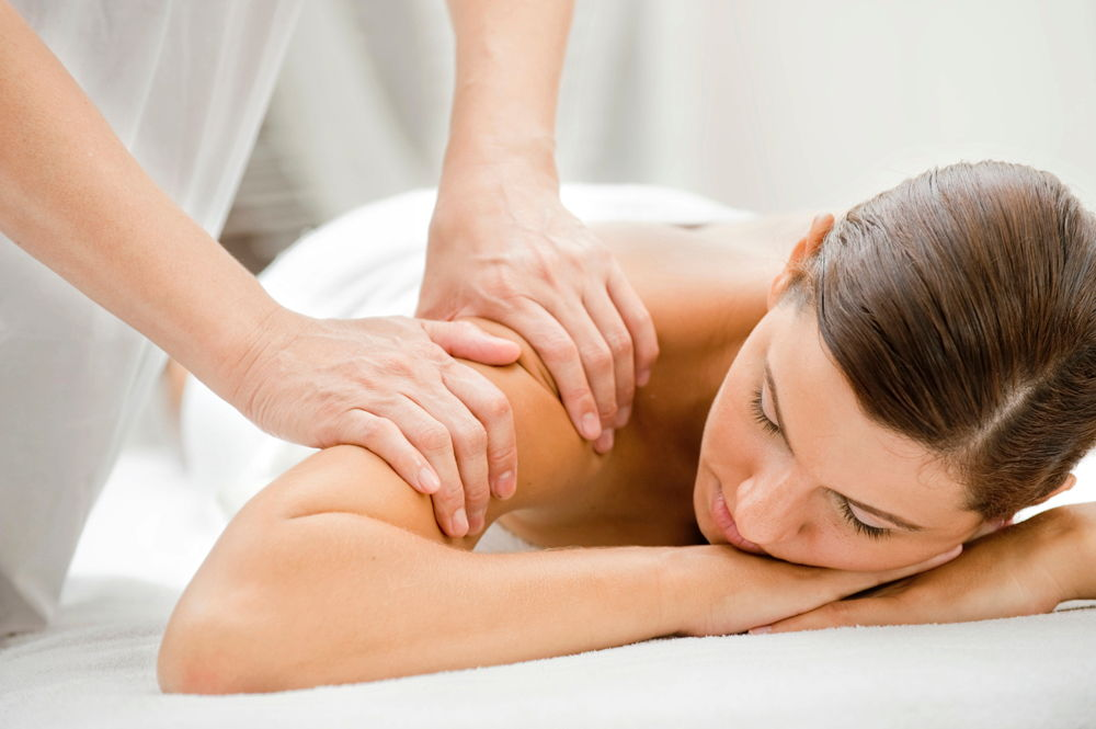Woman receiving massage therapy in Coon Rapids